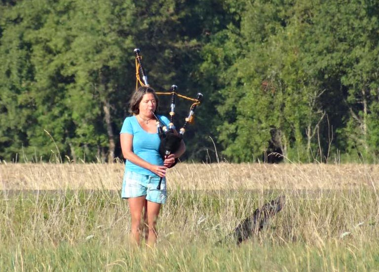 Eclipse chasers took many forms. Here, out standing in a field, was a bagpipe lady near Halsey, Oregon - moments before the eclipse.  Photo by Pat Brown