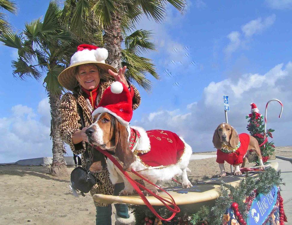 Christmas at our annual Sandy Claws event - with Elvis n Dude back in the day, as Chairperson of the Dog Beach Committee of Ocean Beach Town Council.  Photo: (c) Barb Ayers, DogDiary.org