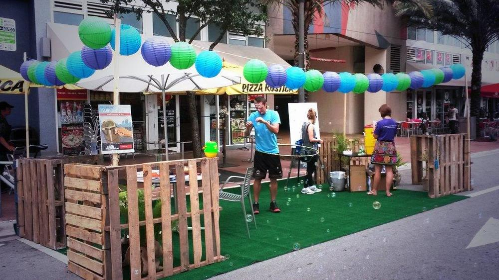 Miamians taking part in last year's PARK(ing) Day