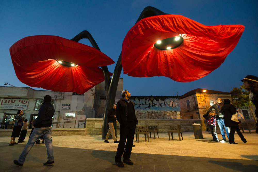 Giant flowers in Jerusalem are motion-activated. They bloom when pedestrians walk by or a trolley arrives.