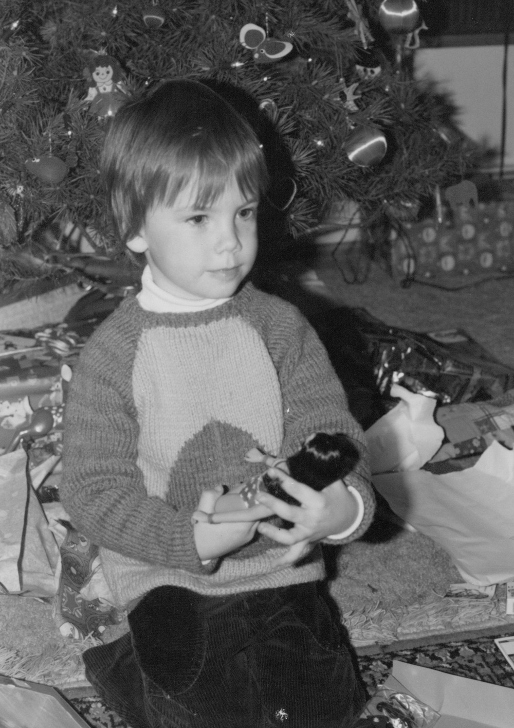 Notice the beatific expression on the author's face as he holds his newly unwrapped Wonder Woman doll.