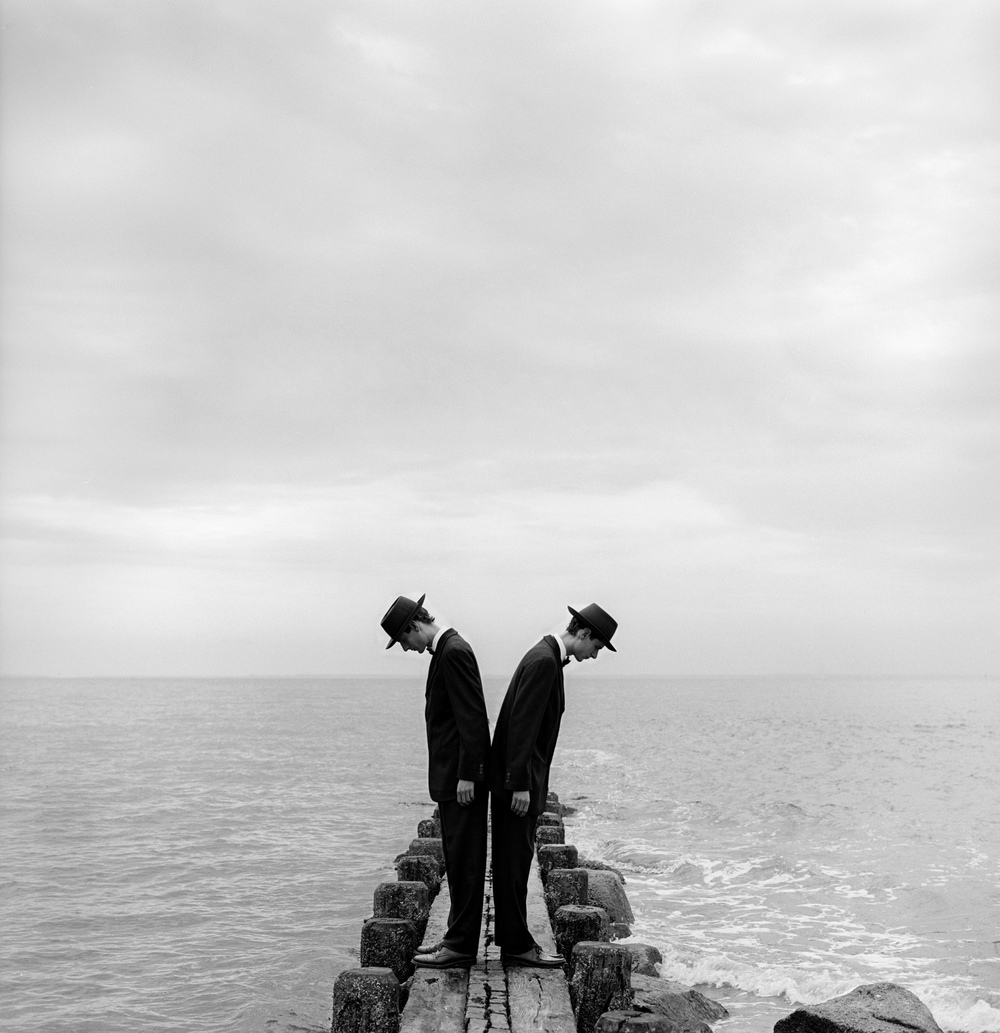 Twins Leaning Outward on Dock no.1, Sherwood Island, CT  1997 Silver gelatin print 27 x 27 cm (image) 56 x 66 cm (mount)