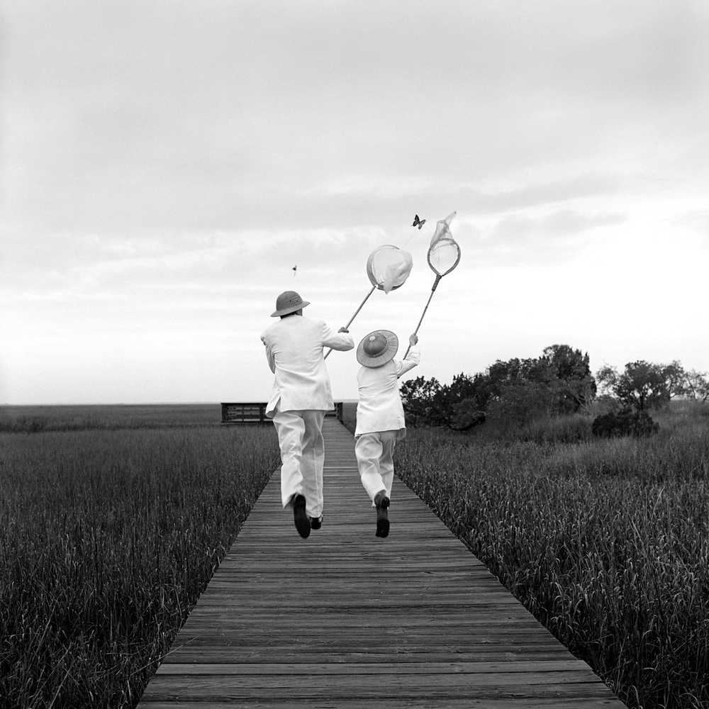 Gary and Henry Chasing Butterfly, Beaufort, SC  1996 Silver gelatin print 27 x 27 cm (image) 56 x 66 cm (mount)