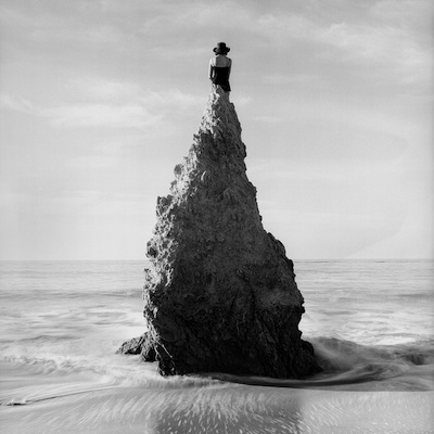 "Caroline on Pointed Rock, near Los Angeles, California  1998 Silver gelatin print 10.5 x 10.5"" (image) 22 x 26"" (mount)"