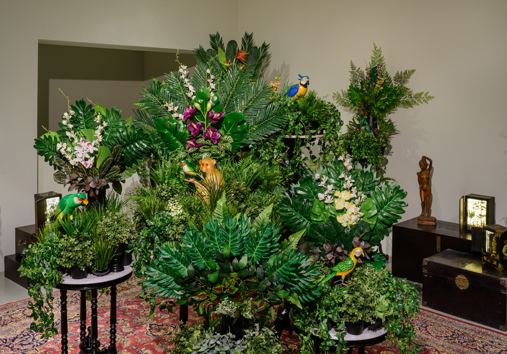 Installation View of  From the Tropics, With Love (2.1)  2016 Antique/reproduction antique wood and marble furnitures, artificial flowers, vases, pots, ceramic monkey and four wooden birds Dimensions variable Photo Credit: Fotograffiti (John Yuen)