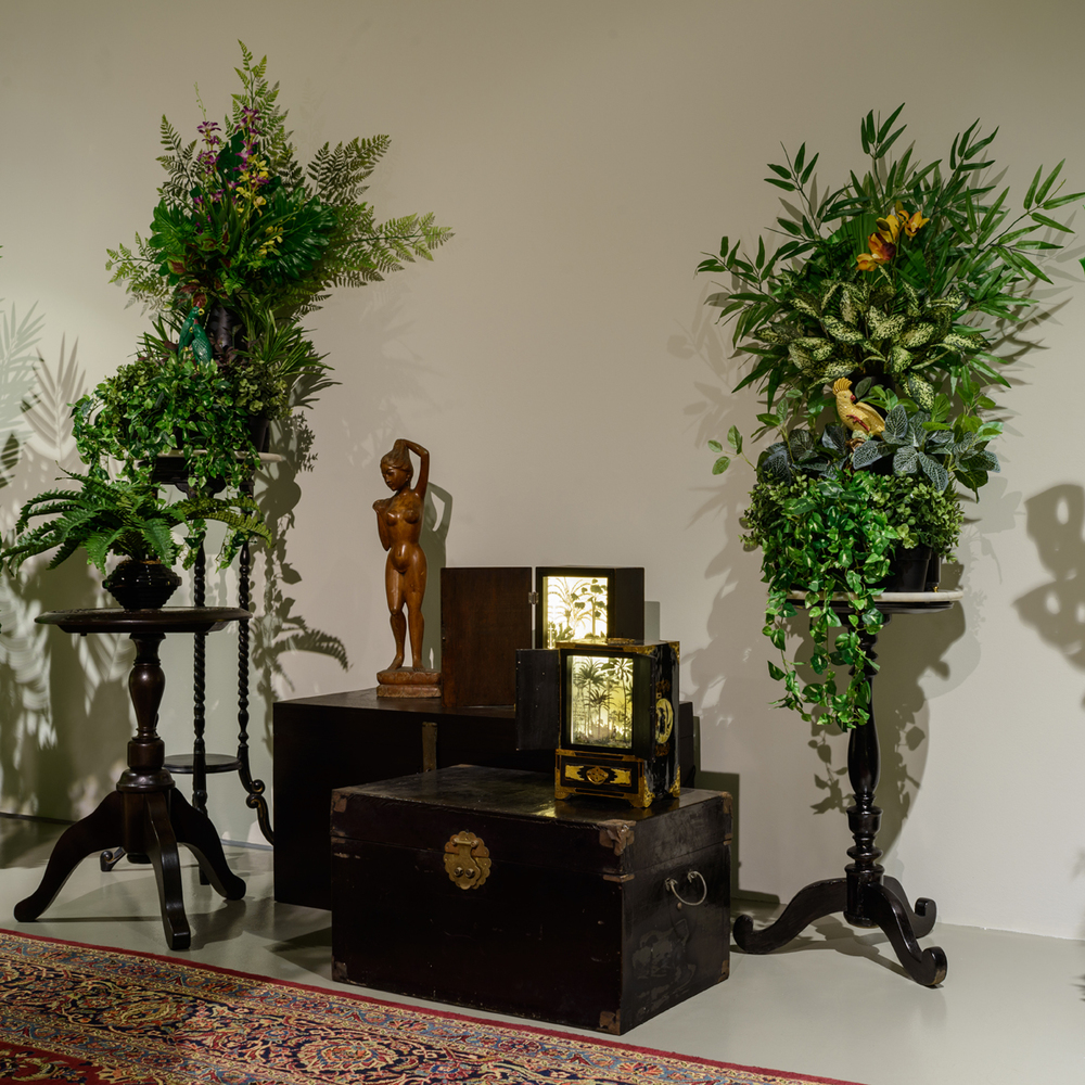 Installation View of  From the Tropics, With Love (2.4)  2016 Antique/reproduction antique wood and marble furnitures, artificial flowers, vases, pots and three ceramic birds Dimensions variable Photo Credit: Fotograffiti (John Yuen)