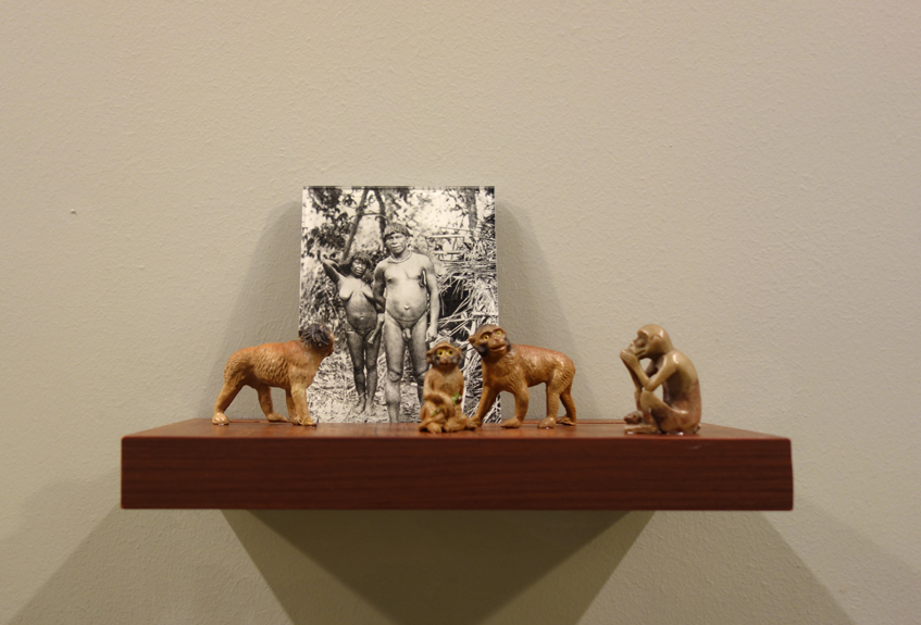 Donna ONG  Postcards from the Tropics (ix)  2016 Diasec print, wooden shelf, and tropical souvenirs (vintage wooden monkeys and stone monkey) Dimensions variable