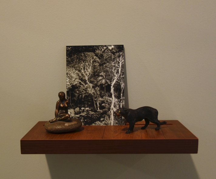 Donna ONG  Postcards from the Tropics (vii)  2016 Diasec print, wooden shelf, and tropical souvenirs (bronze statuette on pebble and vintage wooden panther) Dimensions variable