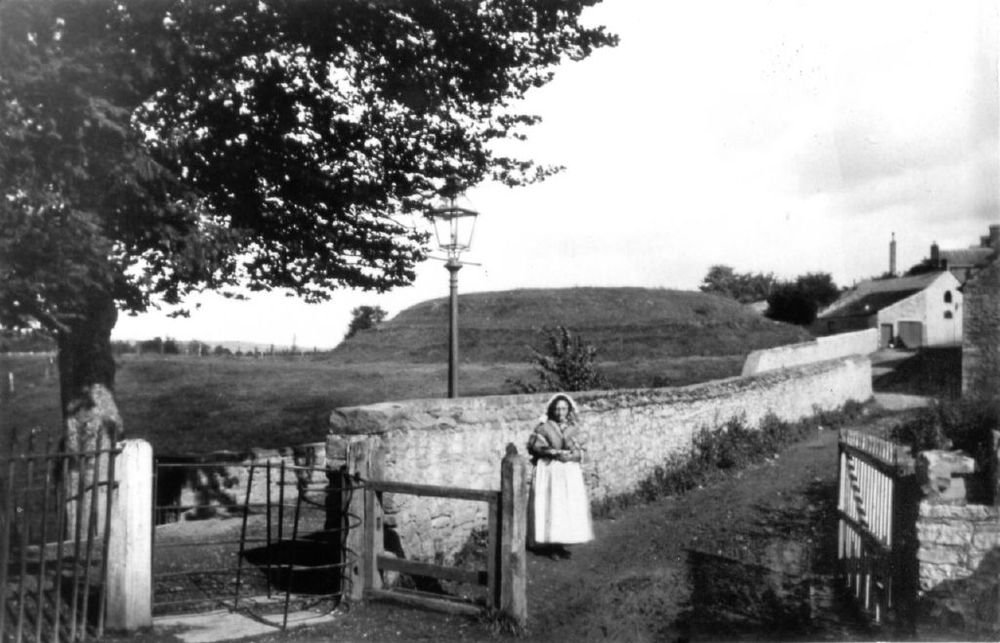 Another view of the motte & bailey castle mound. This showing the former toll gate near St Mary's Church.