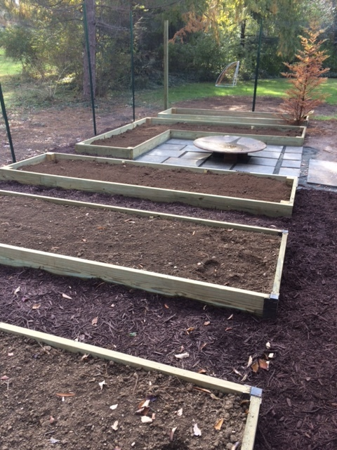Raised Garden Beds around a Firepit seating area.