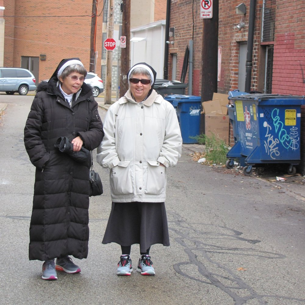 Sisters Theresa and Norma begin their day by walking the streets and alleys in several Pittsburgh neighborhoods.