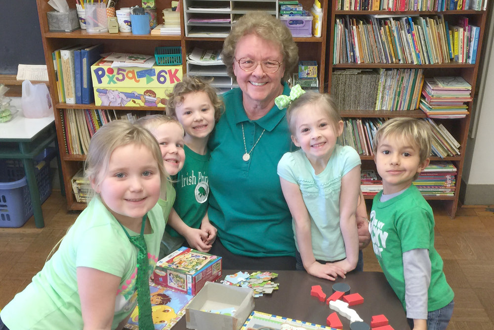 Sister Rosalia Giba, OSF, celebrates Green Day with a group of youngsters at Mount Assisi Academy Preschool.