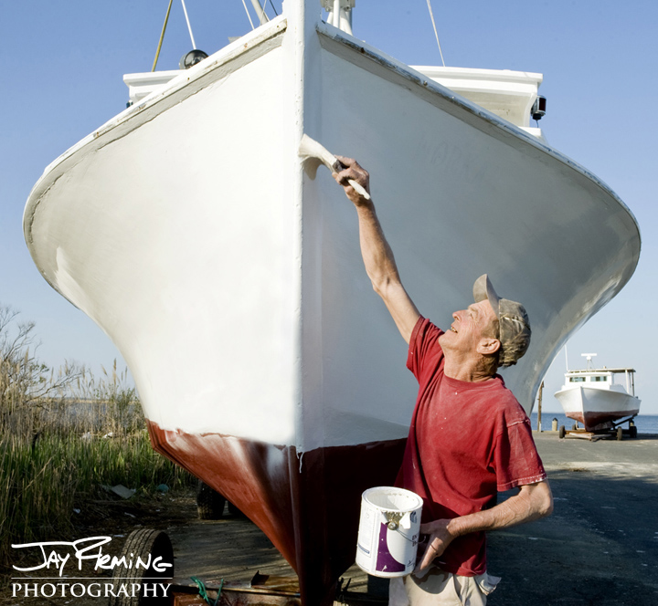 Mark Holitik prepares the wooden workboat 'Workaholic' for the 2014 crabbing season. Crocheron, Maryland