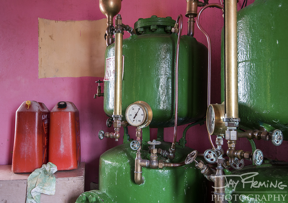 Kerosene is used to power the lantern. These green tanks are manually pressurized with a hand pump and send the fuel up to the lantern room where it is vaporized and sprayed into the mantle.