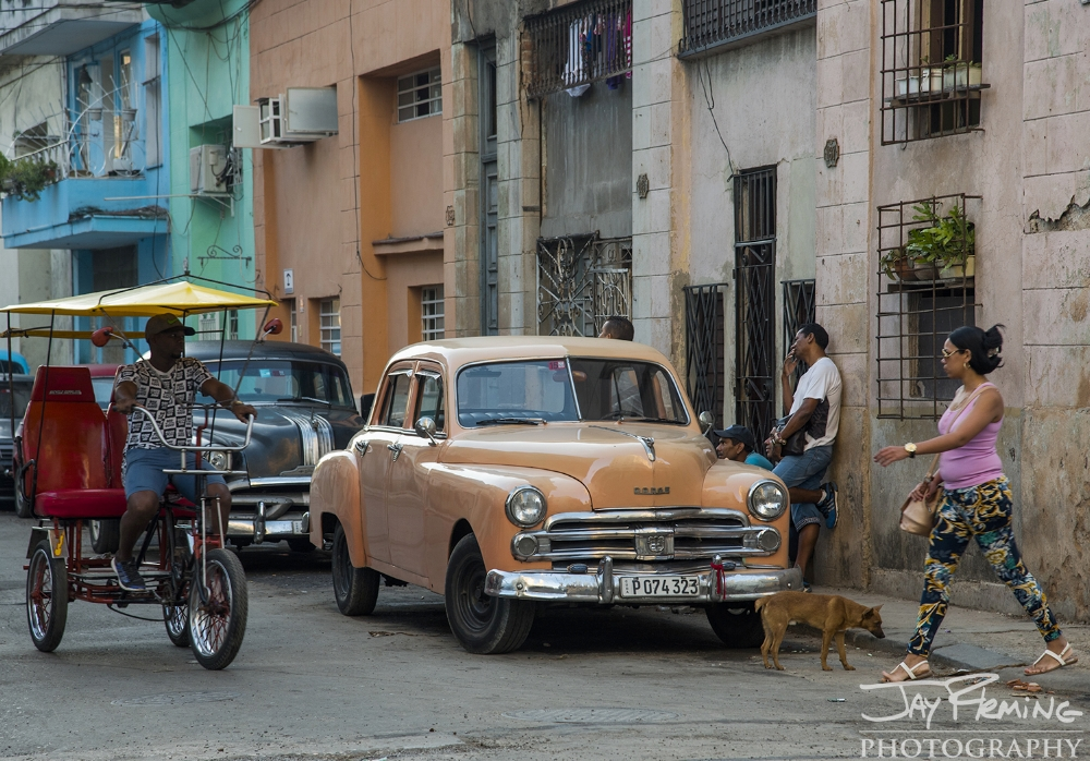 Morning commute on Calle San Miguel, Central Havana
