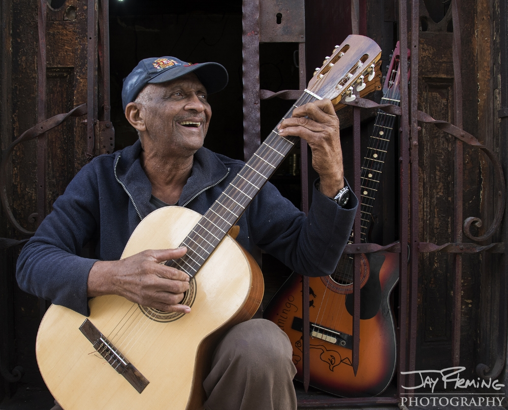 Joyfully playing music near calle Obispo in central Havana.