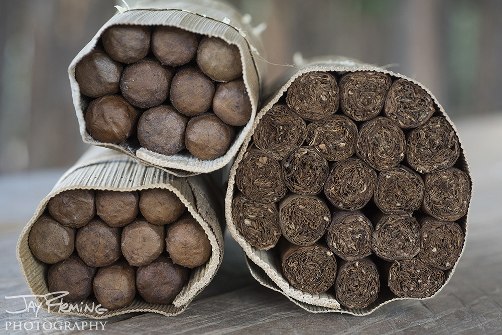 Hand rolled cigars from a plantation outside of Vinales. Farmers are required to sell 90% of their tobacco to the government - the remaining 10% can be sold independently. Cigars are wrapped in royal palm leaves - acting as a natural humidor.