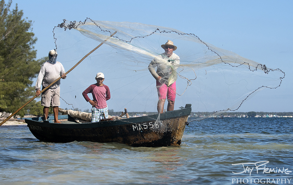 Catching baitfish along the shores of the Bay of Pigs with a cast net. Many cuban fishermen have gear that was generously donated or traded by tourists. Modern day fishing equipment is unavailable to Cubans, with the exception of the government.
