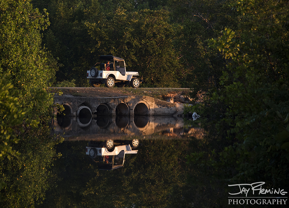 A taxi driving over one of the many small tributaries that empties into the Bay of Pigs