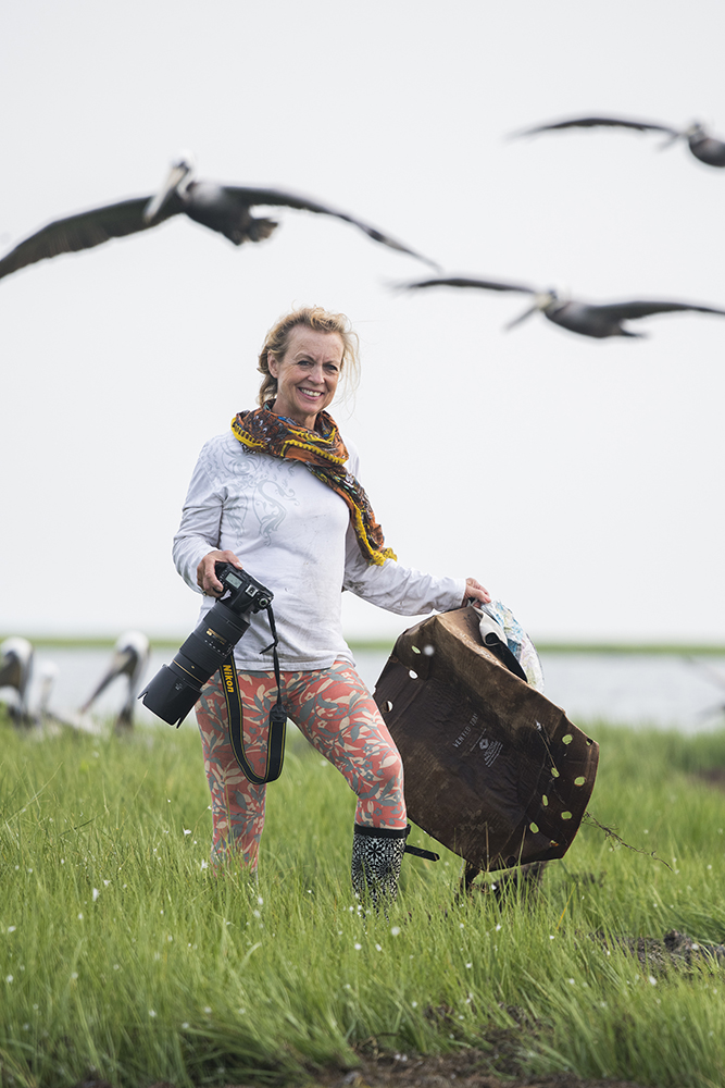 "One of my favorite moments of the trip was when Janice Anderson stopped shooting to pick up trash, she wanted to leave the marsh ""better than the way we found it"""