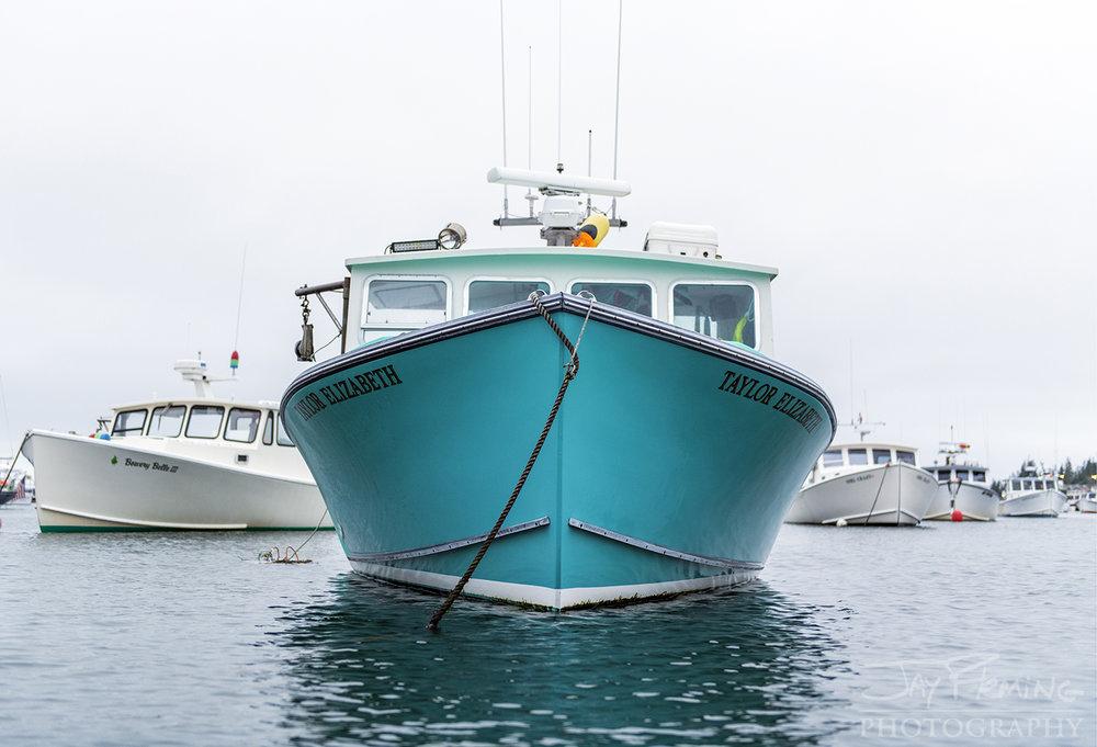 Workboats moored in Carver's Harbor on Vinalhaven Island.