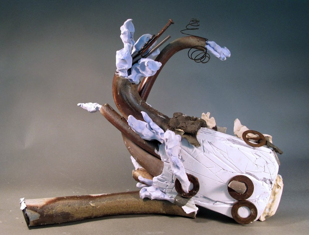 "Sara Fine-Wilson,   Milk Bone Spewing ,  clay, plaster, silicone and found objects, 17""x17""x6"""