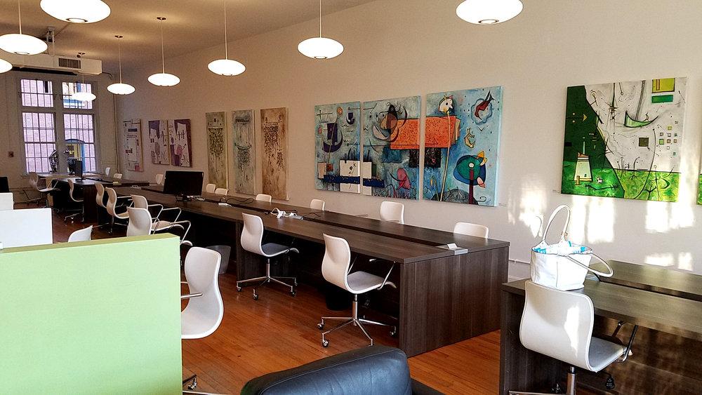 Installation view of Anita Loomis paintings at Oficio