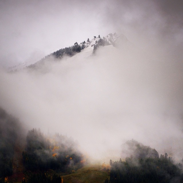 """  The clouds parted to reveal a snow covered Loge Peak at #AspenHighlands. 📷 by  @ozskier"" - @aspensnowmass"