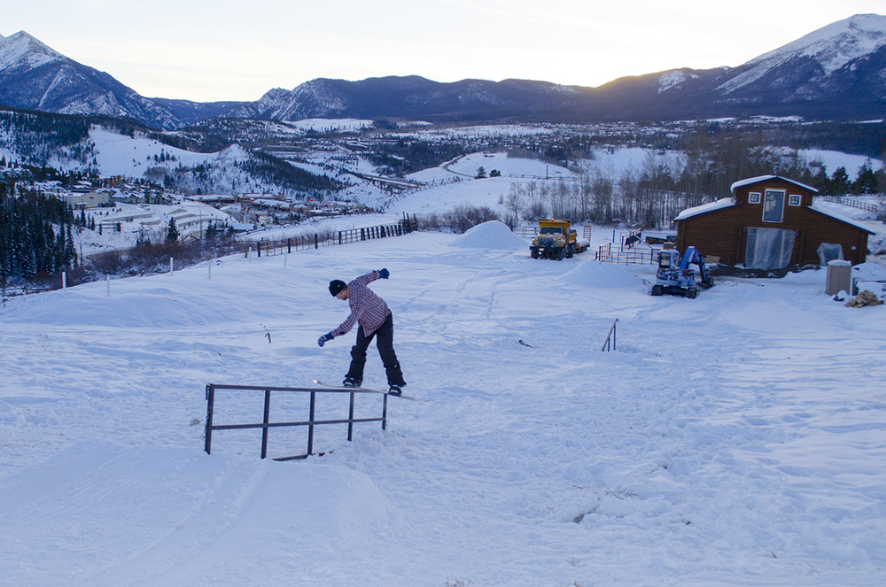 Switch Backside Lipslide as the sun sets over the Rockies.