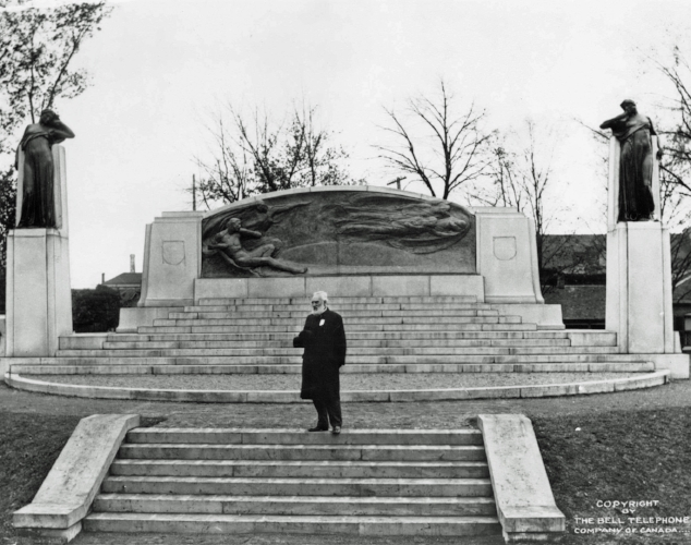 Alexander Graham Bell posing in front of the newly unveiled Bell Memorial