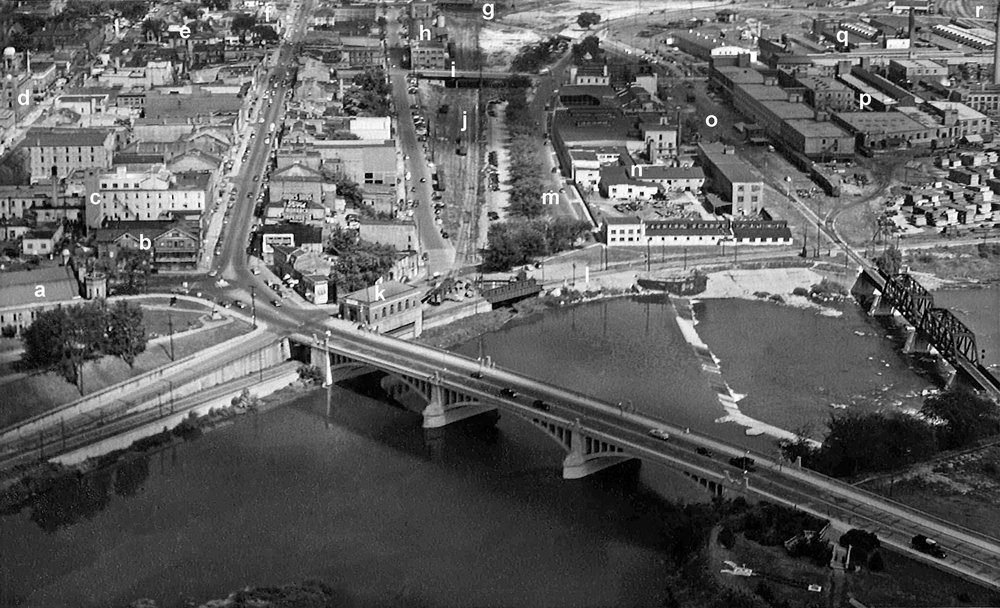 1952 aerial photo of downtown Brantford and Market Street South industrial basin.  Image courtesy of the Brant Historical Society   a) Armoury, b) Prince Edward Hotel, later the Best View Hotel, c) William Patterson & Son Co. Ltd., Confectionery & Biscuit Manufacturers, d) Federal Building, e) City Hall, f) Hotel Kerby, g) Brantford, Norfolk & Port Burwell (CNR) freight shed, h) Lake of the Woods Flour Mill. The mill closed in 1956 and was demolished in the early 1960s, i) Victoria Bridge (Market Street South), j) Interchange yards between the Lake Erie &Northern Railway (LE&N) and the CNR, built over the canal, k) LE&N Railway station, l) LE&N line to Port Dover, m) Greenwich Street, n) Scarfe & Company, paint and varnishes, o) CNR rail line to Tillsonburg, originally the Brantford, Norfolk & Port Burwell Railway, p) Massey-Harris Company, South Market Street plant, q) Waterous Limited, later Koehring-Waterous, then finally Timberjack, r) Freight yards of the Toronto, Hamilton & Buffalo Railway (TH&B).