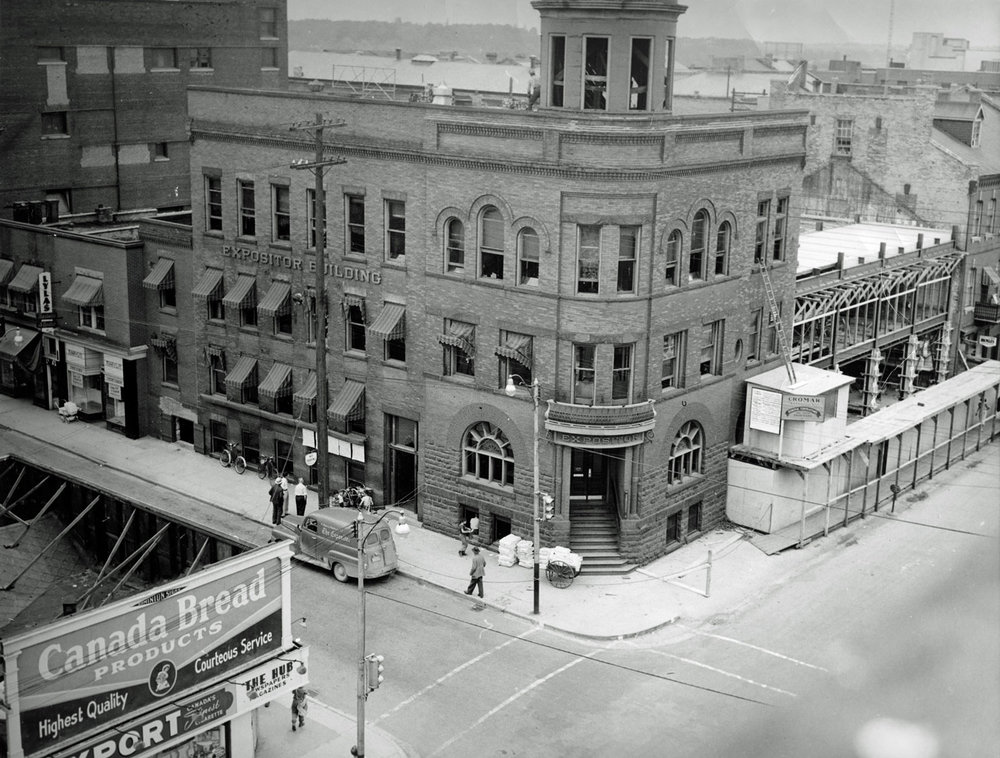 Expositor Building  In 1950 the Expositor built a modern addition onto the west end of their existing building. When the $180,000 addition was completed the cupola and corner entrance would be removed.  Image courtesy of the Brant Historical Society