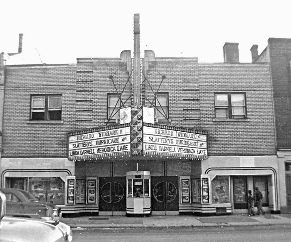 The Esquire Theatre was constructed in1937. It sat 982. The theatre was built in the Art Deco style and featured a Thunderbird centred over the second storey. The ground floor was clad in Vitrolite, an opaque pigmented glass. The theatre closed in 1955.  Image courtesy of the Brant Historical Society