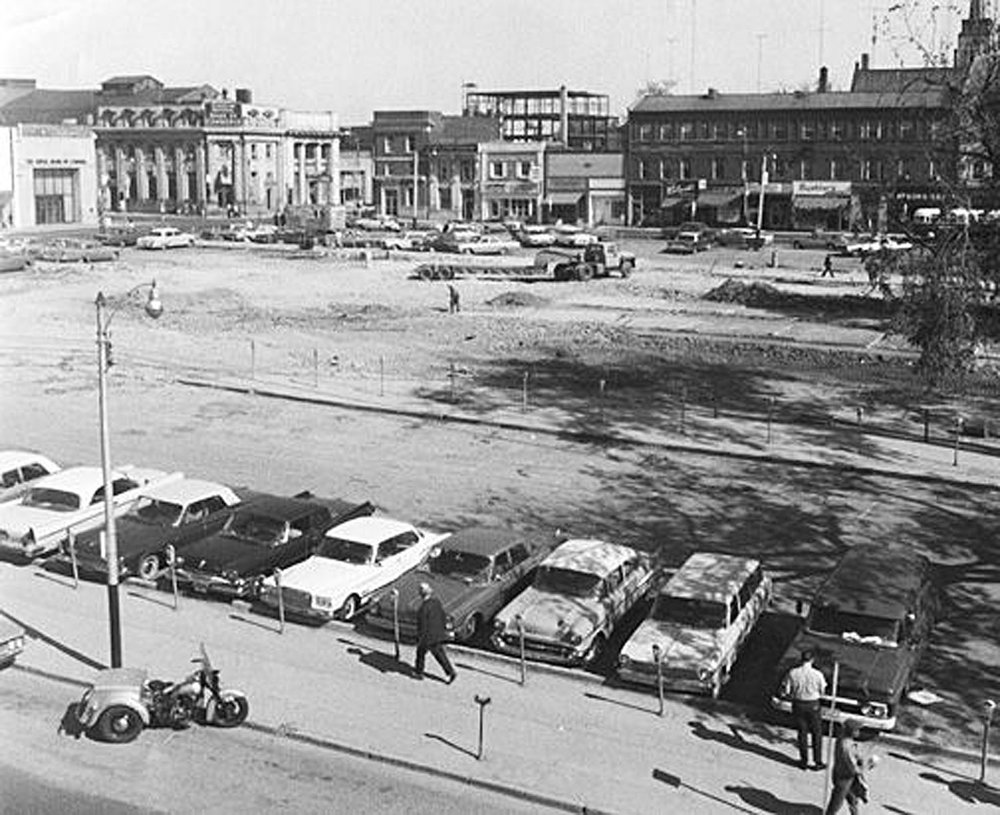 Market Square, September-1965 after the demolition of City Hall. Looking north towards the corner of Dalhousie and Market Streets. The steel skeleton in the top centre of the picture is the new Canada Permanent Trust Building, now the downtown branch of the TD Canada Trust.  Image courtesy of the Brant Historical Society