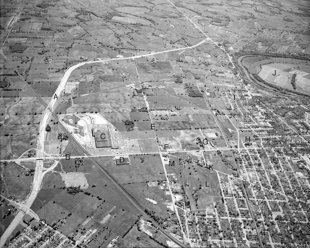 Aerial photo, Braneida, East End  Image courtesy of the Brant Historical Society   A) Highway 403, B) Park Road North, C) Massey-Ferguson North American Combine Plant, D) Ladish Co. of Canada, E) Henry Street, F) Chicago Rawhide Products Canada Ltd., G) Elgin Street, notice the street is not yet connected to the portion south of Stanley Street, H) St. Joseph's Hospital, I) Orchard Park subdivision, J) Bow Park Farm. Established in 1866 by George Brown. Run since 1978 by the Hilgendag family, K) Stanley Street, L) Arrowdale Golf Course, M) Sonnenhof German Canadian Club, N) Morton Avenue, O) West Street.