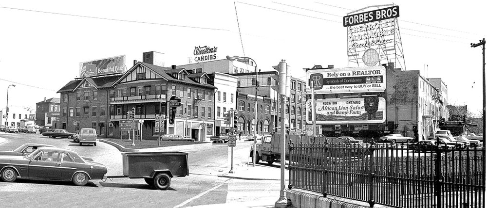 Intersection of Brant Avenue and Colborne Street. Bridge Street was open to connect Dalhousie Street traffic to Colborne Street and the Lorne Bridge. Grand River Avenue was open and connected to Greenwich Street, across the bottom go the picture. Weston's Candies was still in business, until 1976. The Forbes Brothers sign was a landmark at the intersection. ( Image courtesy of the Brant Historical Society )