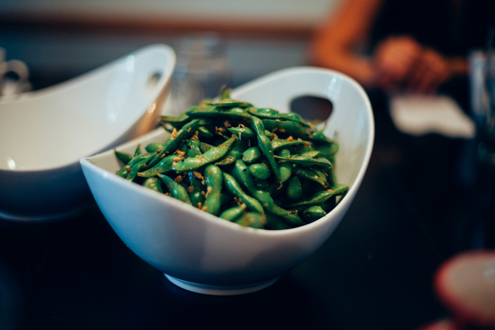 Steamed edamame tossed in sesame oil and garlic.