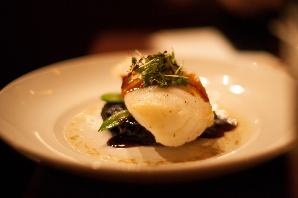 Asian-Glazed Chilean Sea Bass: Organic black rice, snow peas, shiitake mushrooms, micro wasabi.