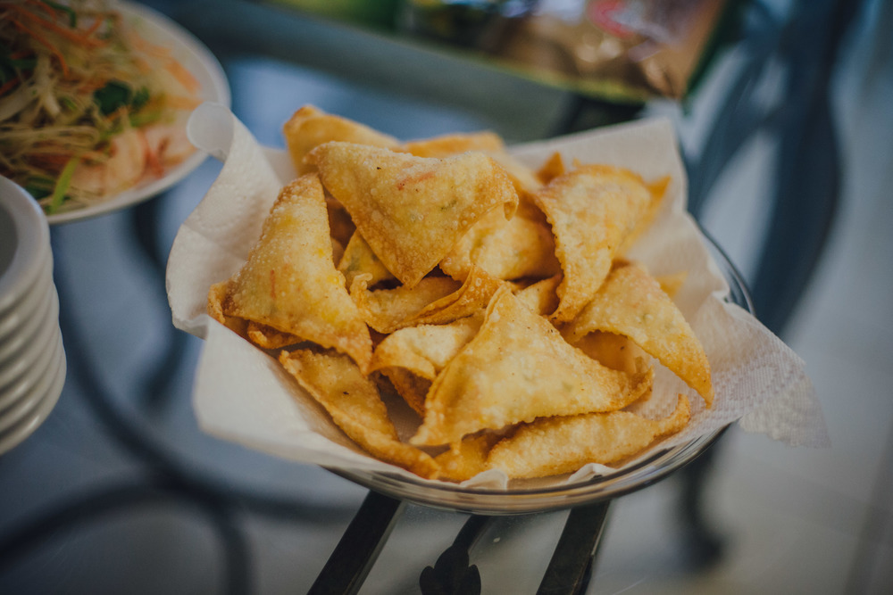 Krab rangoons: Shredded imitation krab blended with cream cheese & chopped veggies, wrapped in wonton wrappers & deep fried.