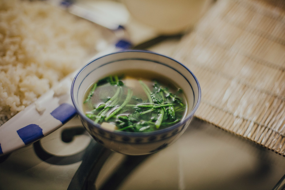 Miso soup with soft tofu & watercress.