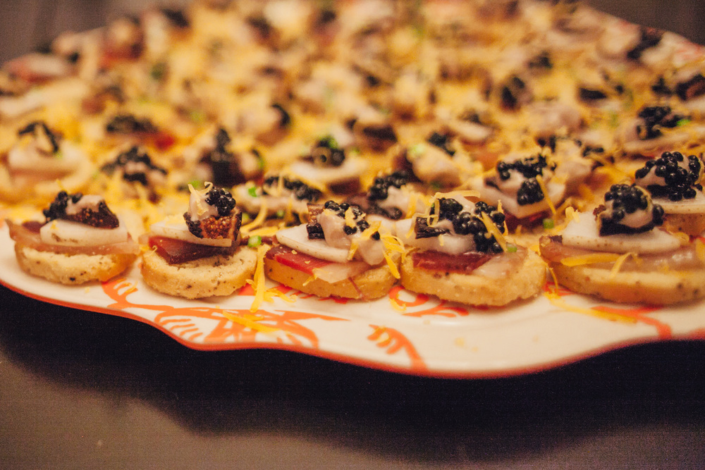 Crostini with duck prosciutto, caviar and dried figs.
