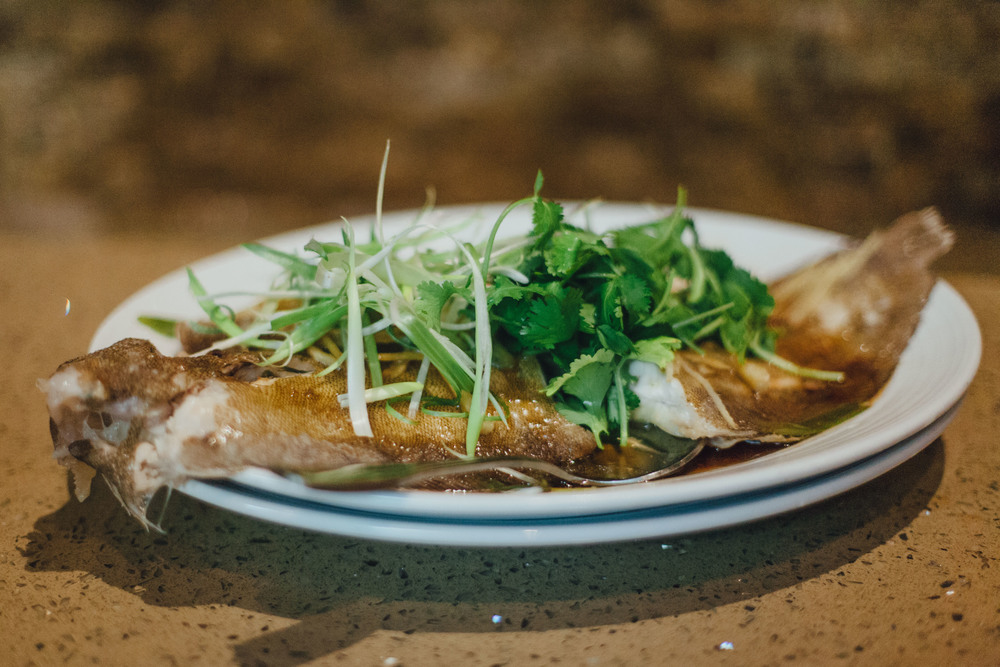 Whole Flounder Supreme: A whole Holland flounder prepared in a ginger/scallion sauce, topped with fresh cilantro and finely sliced scallions.