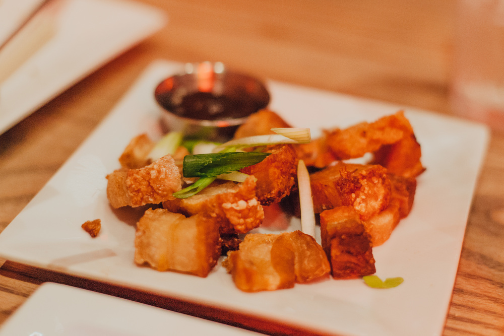 Crispy Roast Pork Siu Yoke:Seasoned tender pork belly, roasted to a crisp and served with a hoisin dipping sauce.