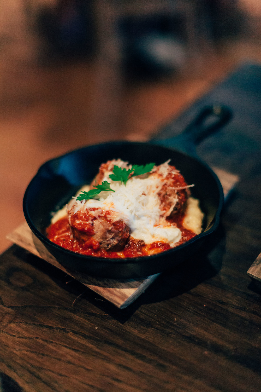 Lamb Meatballs: Minted ricotta, tomato-date sauce, Anson Mills grits.
