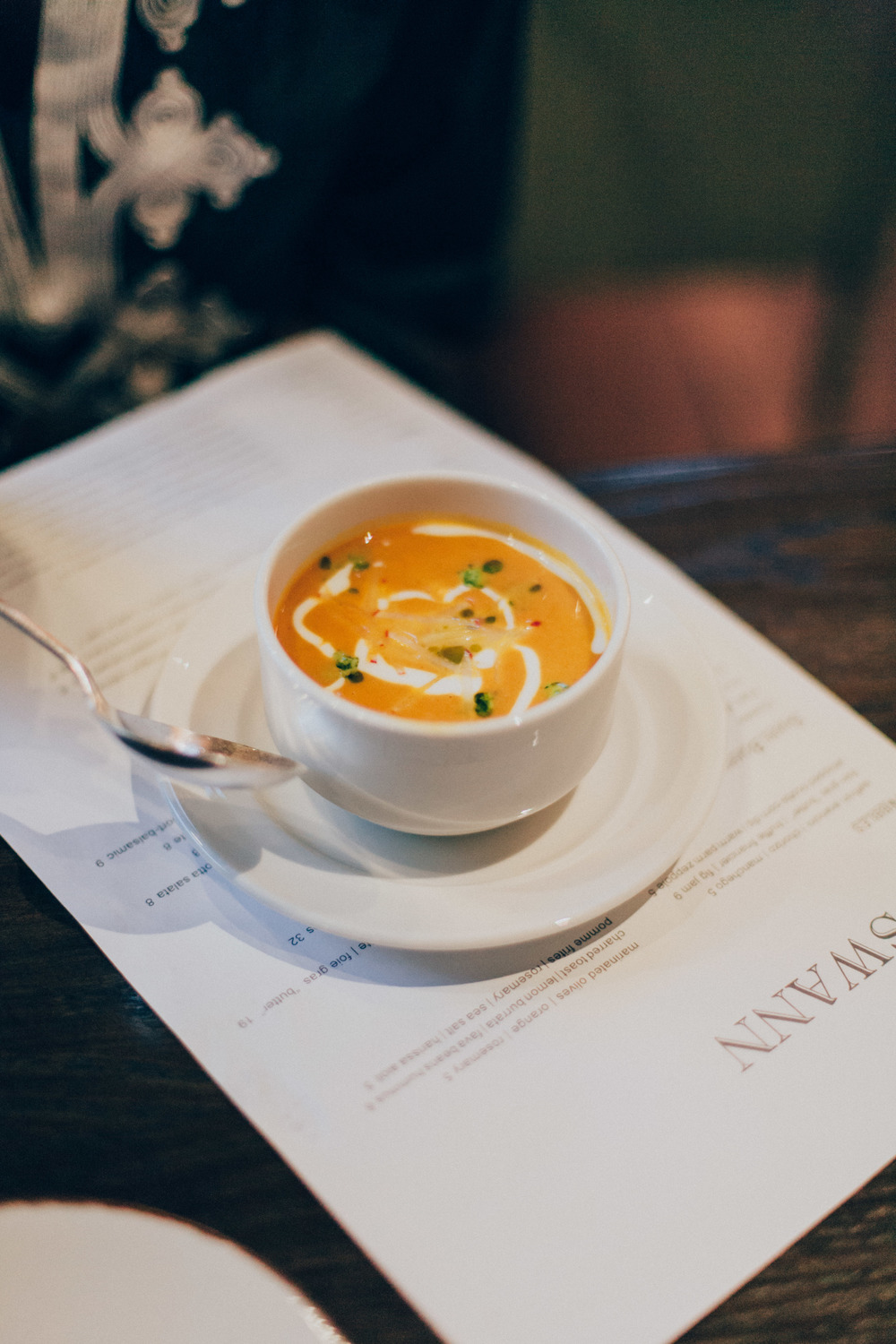 Spiced Carrot Soup - Red lentils, buttermilk creme, radish & mint-pea pesto.