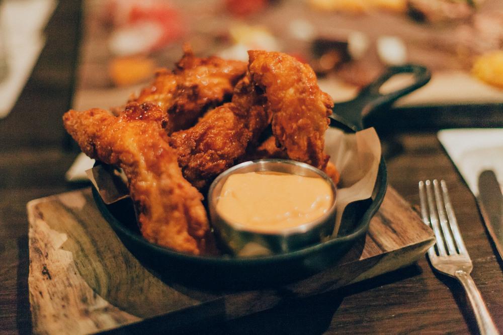 Hot Chicken - Crispy tenders, paprika honey butter & romseco aioli.