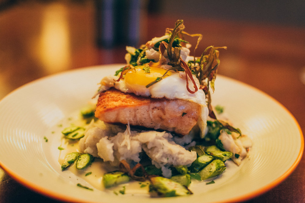 "Scottish Loch Duarte Salmon ""Oscar"": North Atlantic salmon topped with a fried egg, blue crab salad and wilted arugula, over boniato mash, asparagus and blood orange butter"