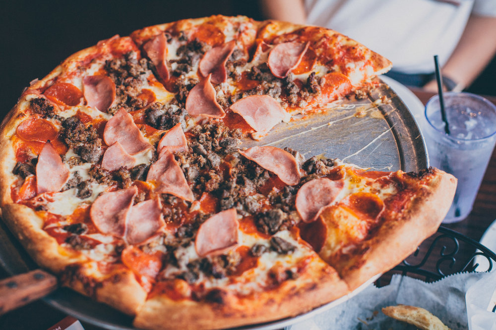 Mulberry Pizza: Crumbled spicy Italian sausage, pepperoni, Canadian bacon, beef, and all-natural mozzarella cheese, with our homemade pizza sauce