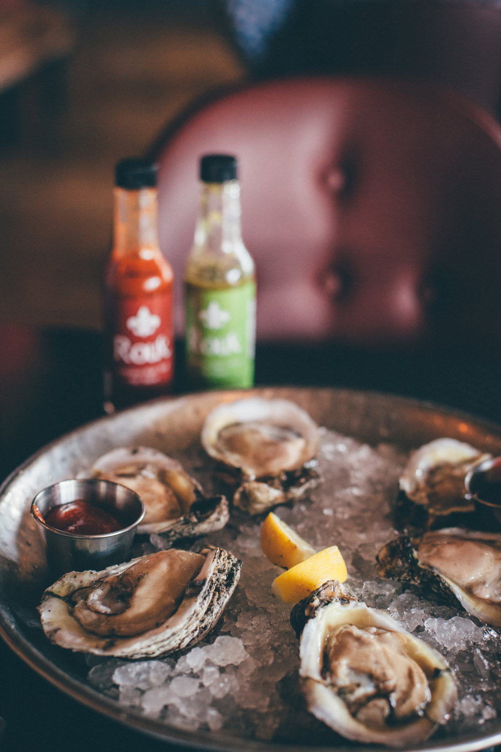 Oysters on the half shell, served with Cajun cocktail sauce and Creole mignonette.