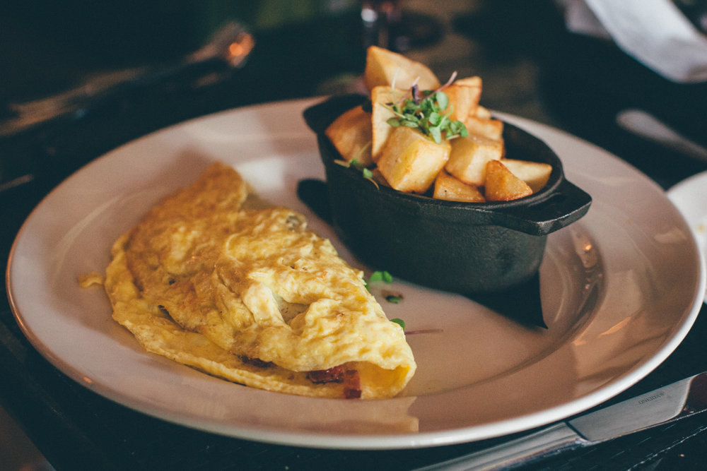 Create Ya' Own Omelet: Nueske's bacon, andouille sausage and gouda, served with garlic brabant potatoes.